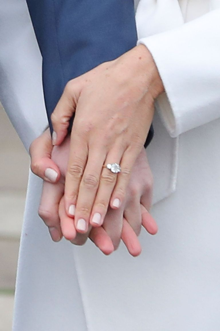 Harry designed the ring himself and had it made by court jewelers Cleave and Company. It features a round brilliant diamond from Botswana and two smaller round diamonds from Diana's collection, set in Megan's favorite, yellow gold.