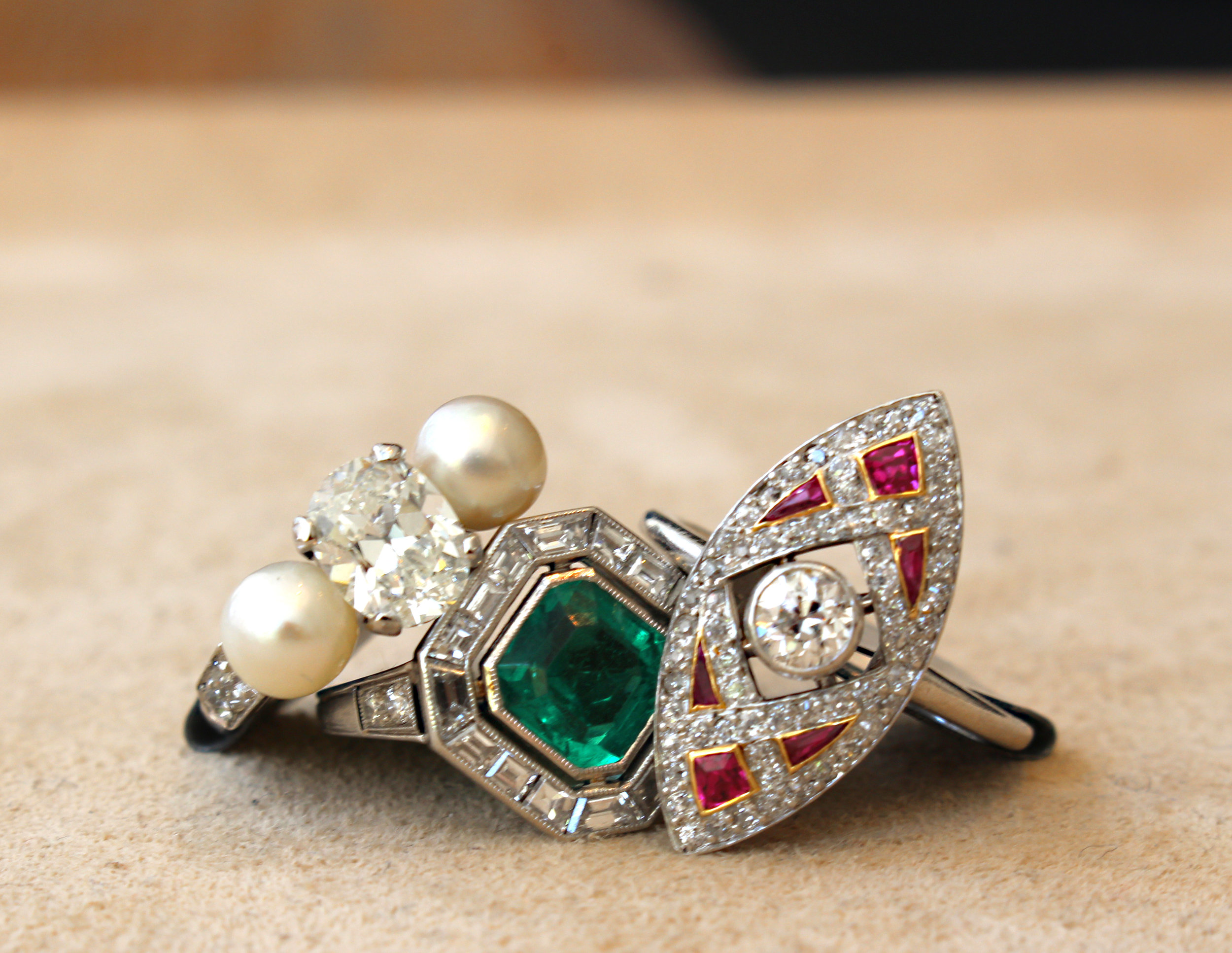 Early Art Deco diamond and cultured pearl ring.   Cartier Art Deco emerald and diamond ring.   Tiffany Edwardian ruby and diamond navette ring.