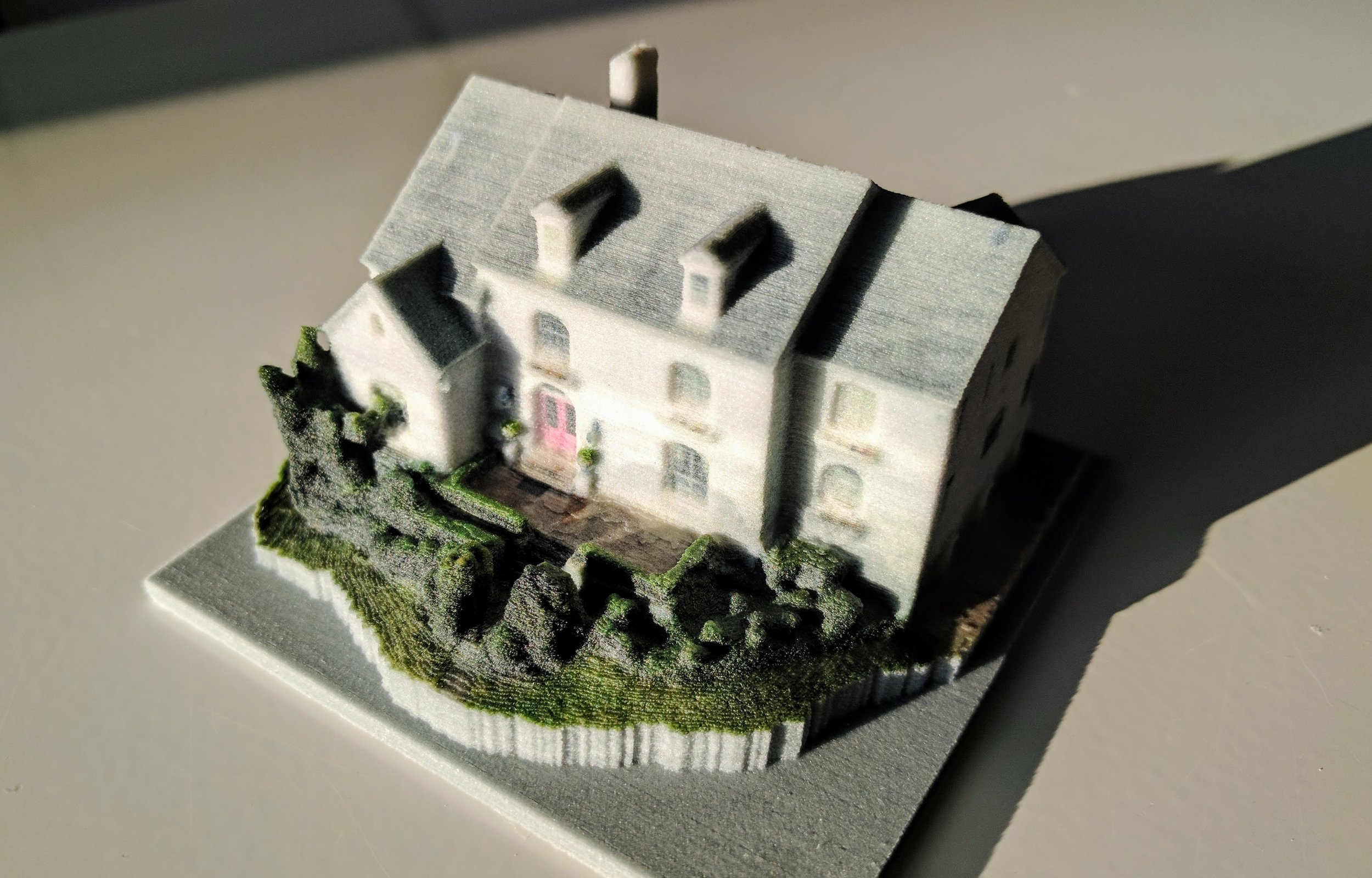 The digital 3D model of the house, printed in 3D color (sandstone)