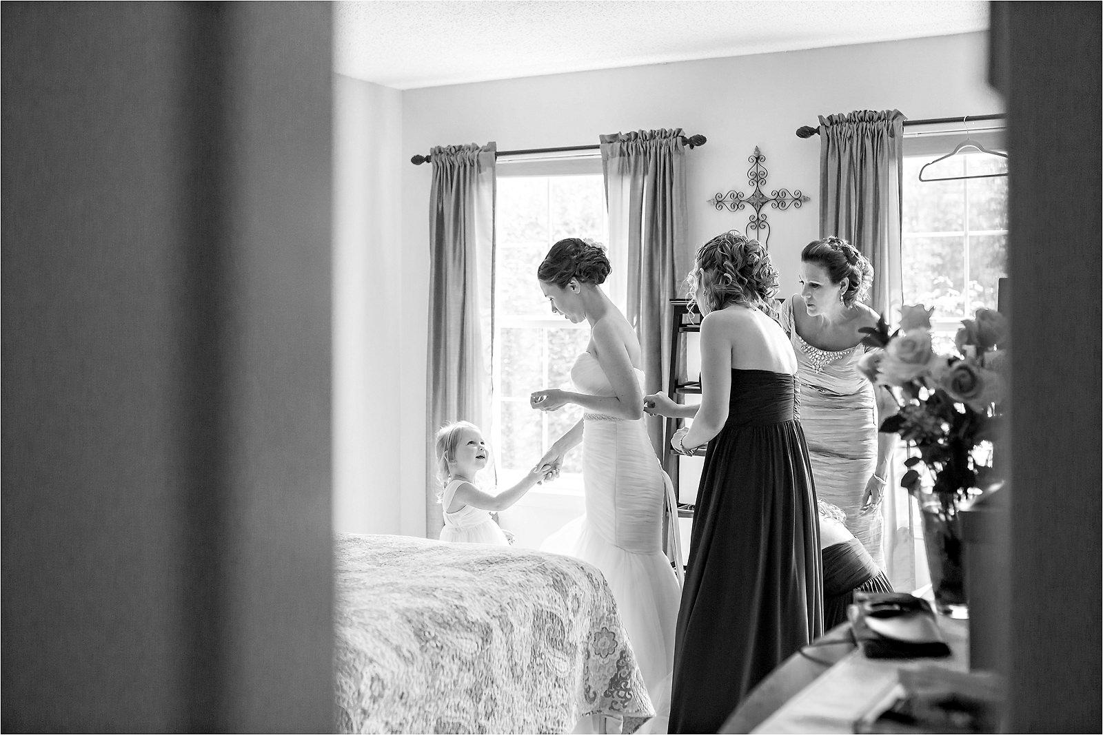 flower-girl-holding-brides-hand
