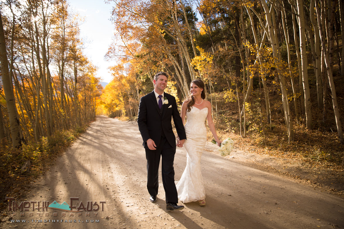 colorado-bride-and-groom-walking-down-nature-trail