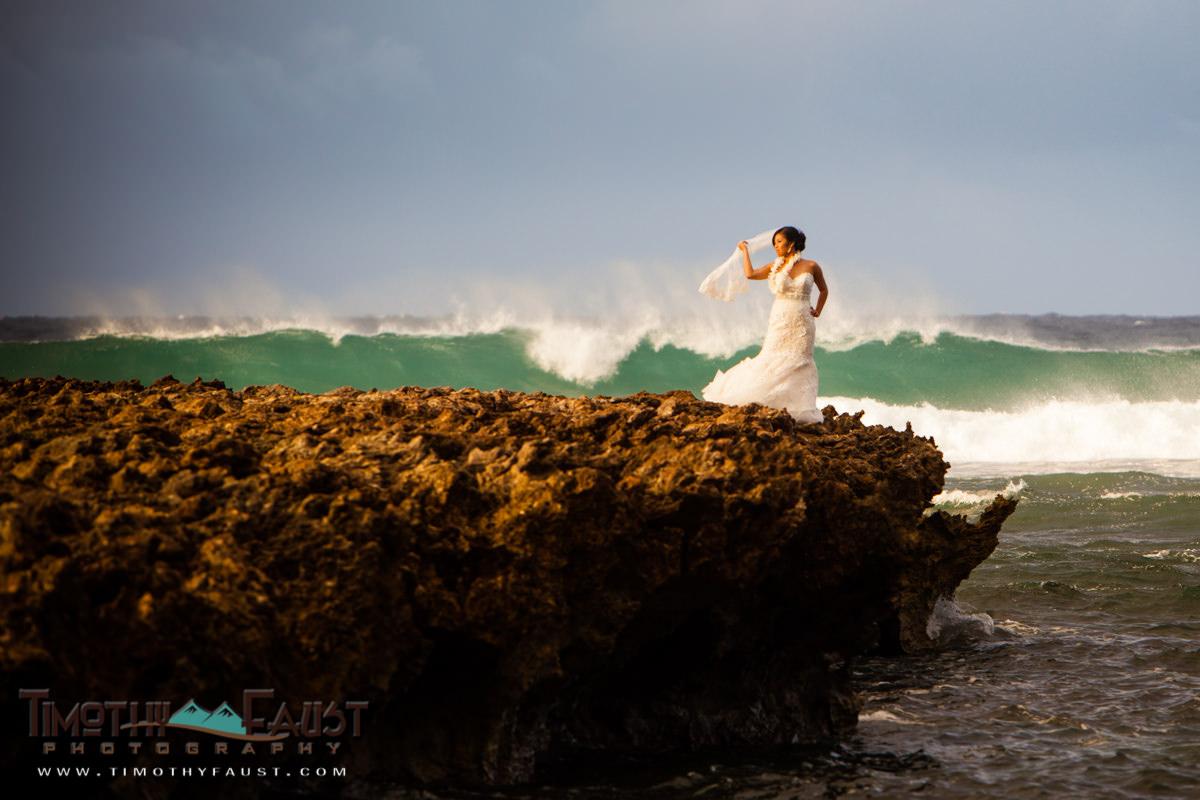 bride-in-wedding-dress-on-beach-reef