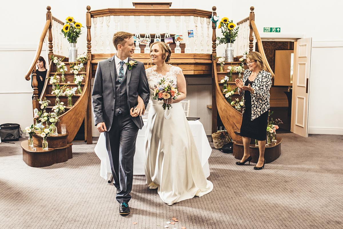 bride-groom-walking-down-aisle-kent-uk