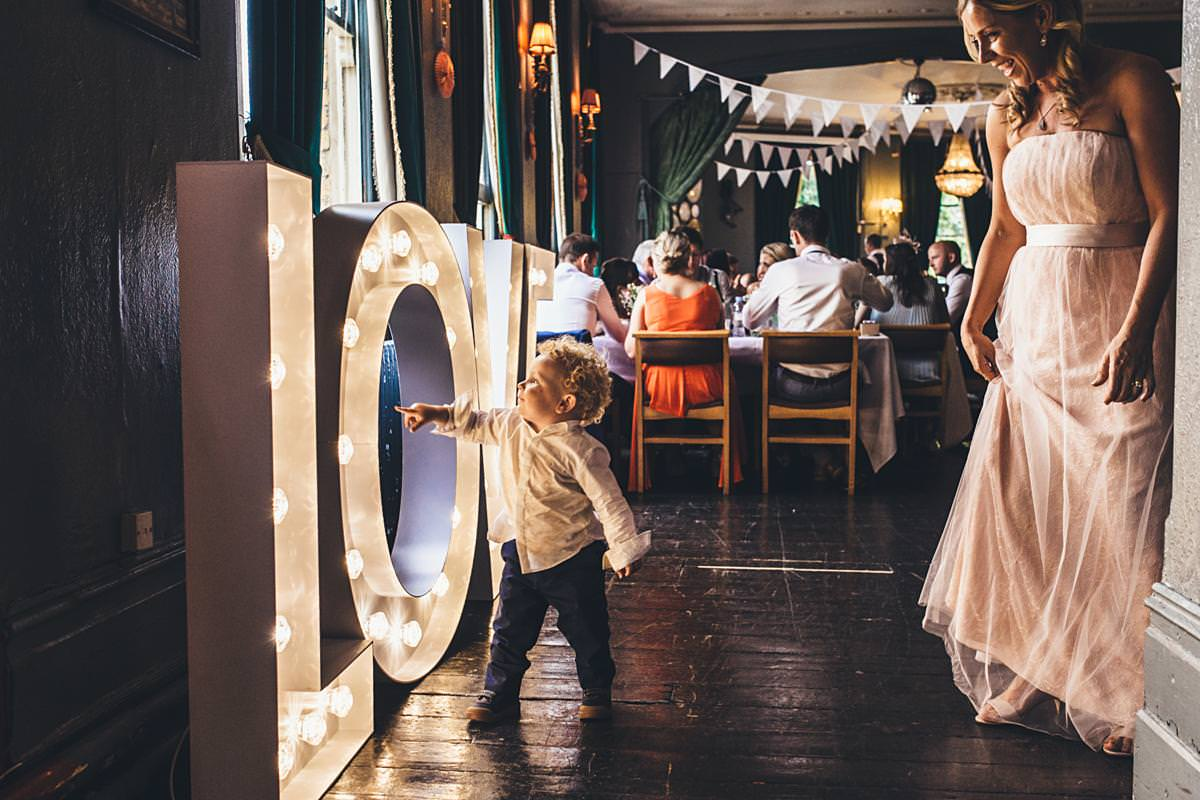 kid-at-wedding-playing-with-decorations