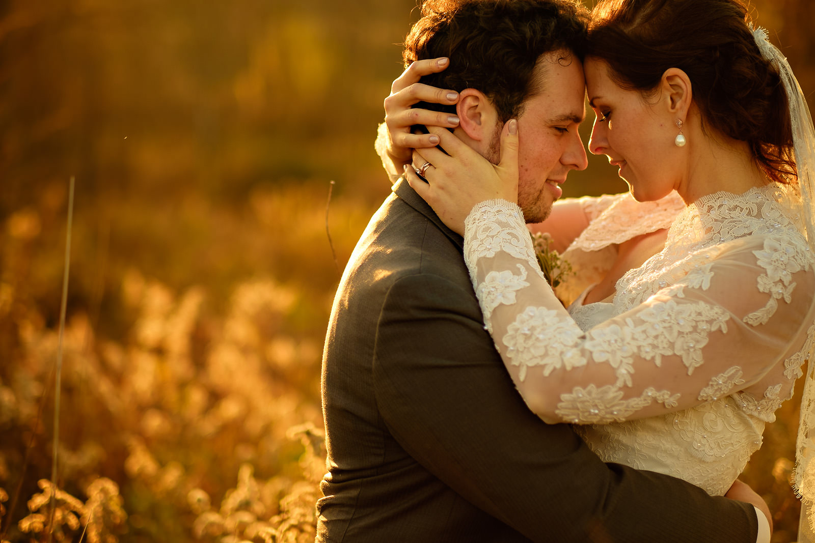 bride-hugging-groom-passionately-wheat-field