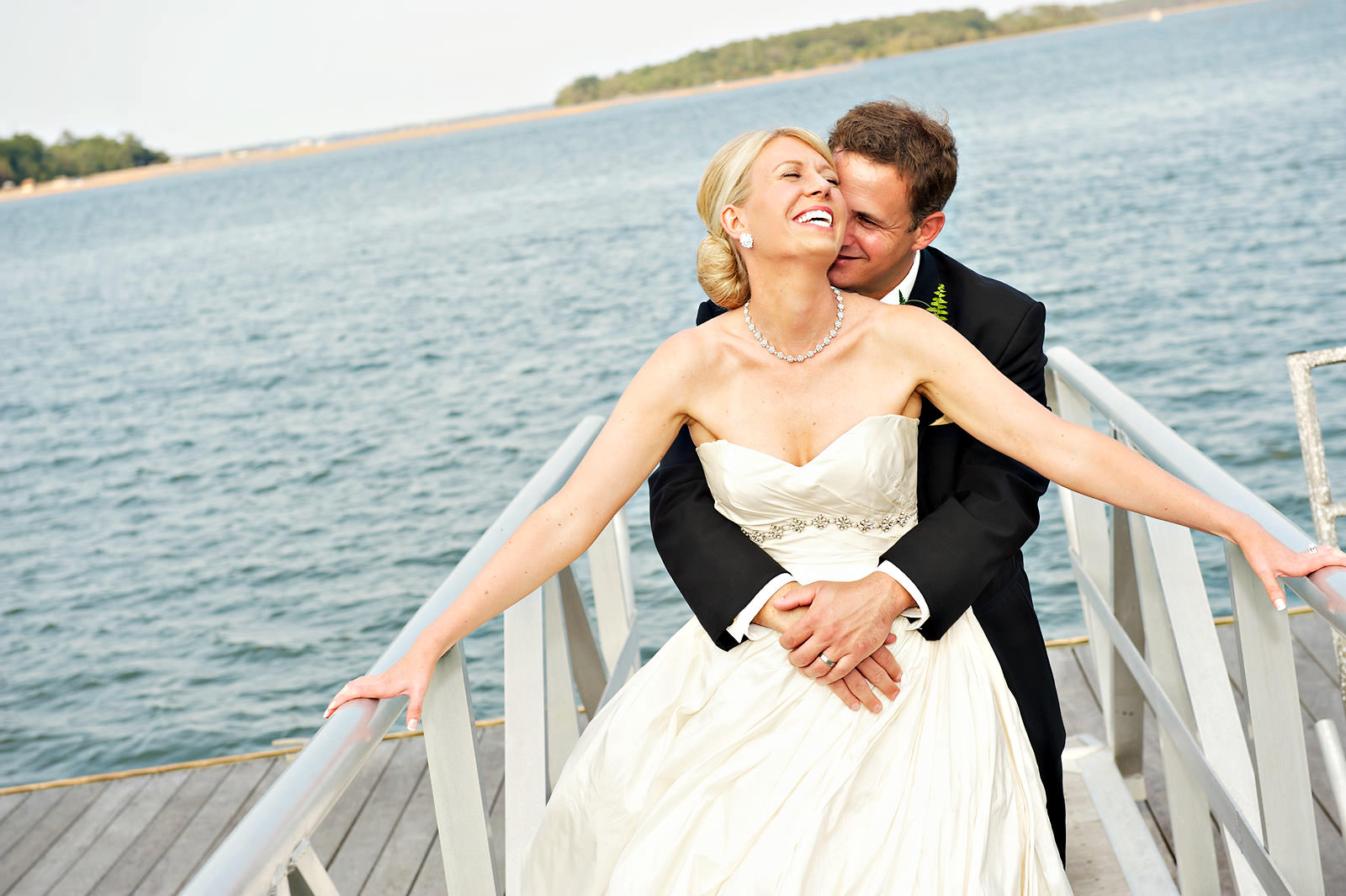 Bride-groom-laughing-lake-front