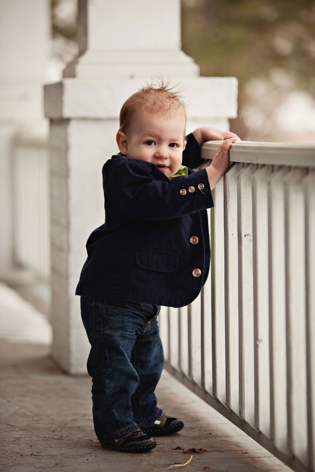 toddler-wearing-blazer-looking-over-railing