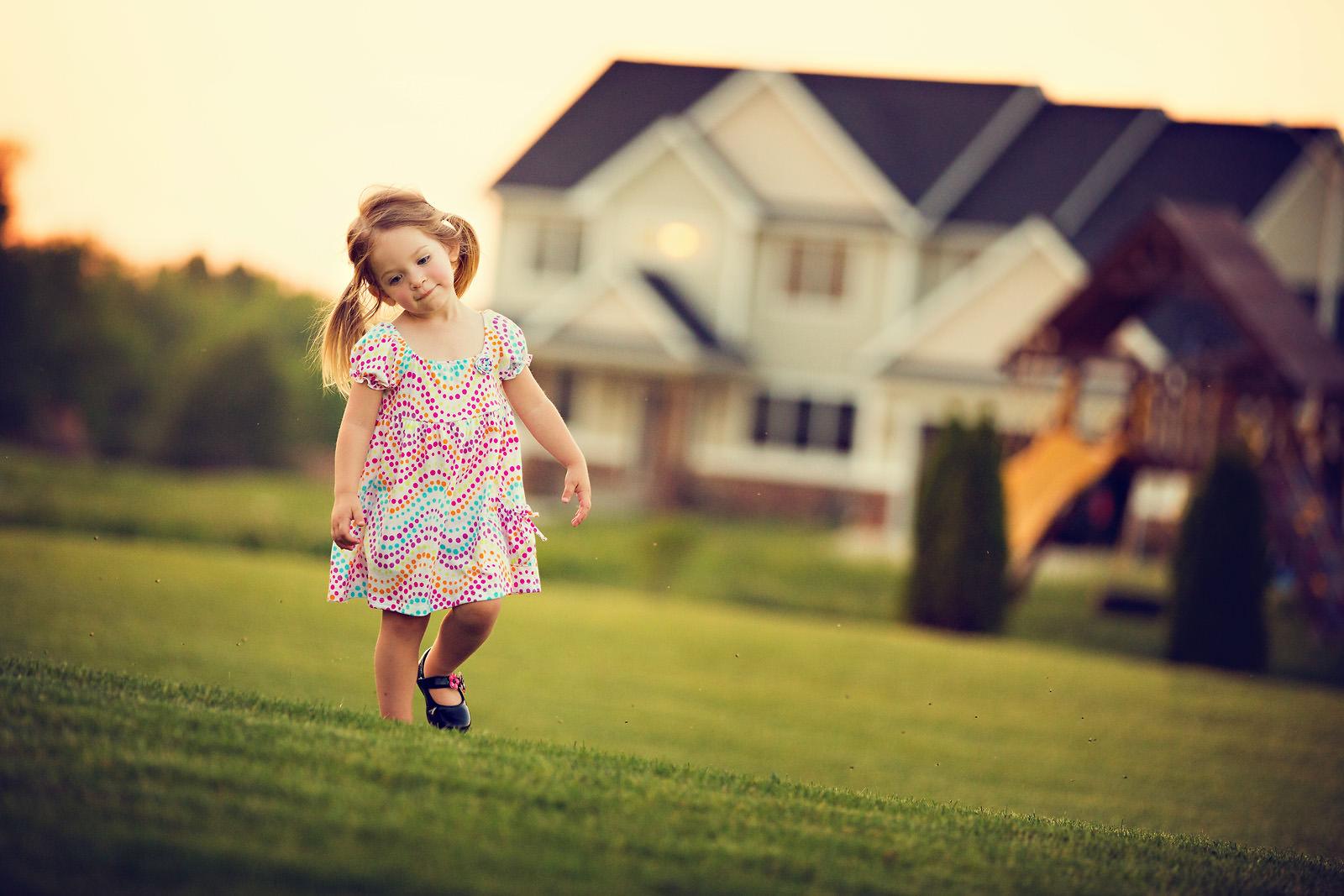 toddler-girl-walking-around-backyard-grass-sunset
