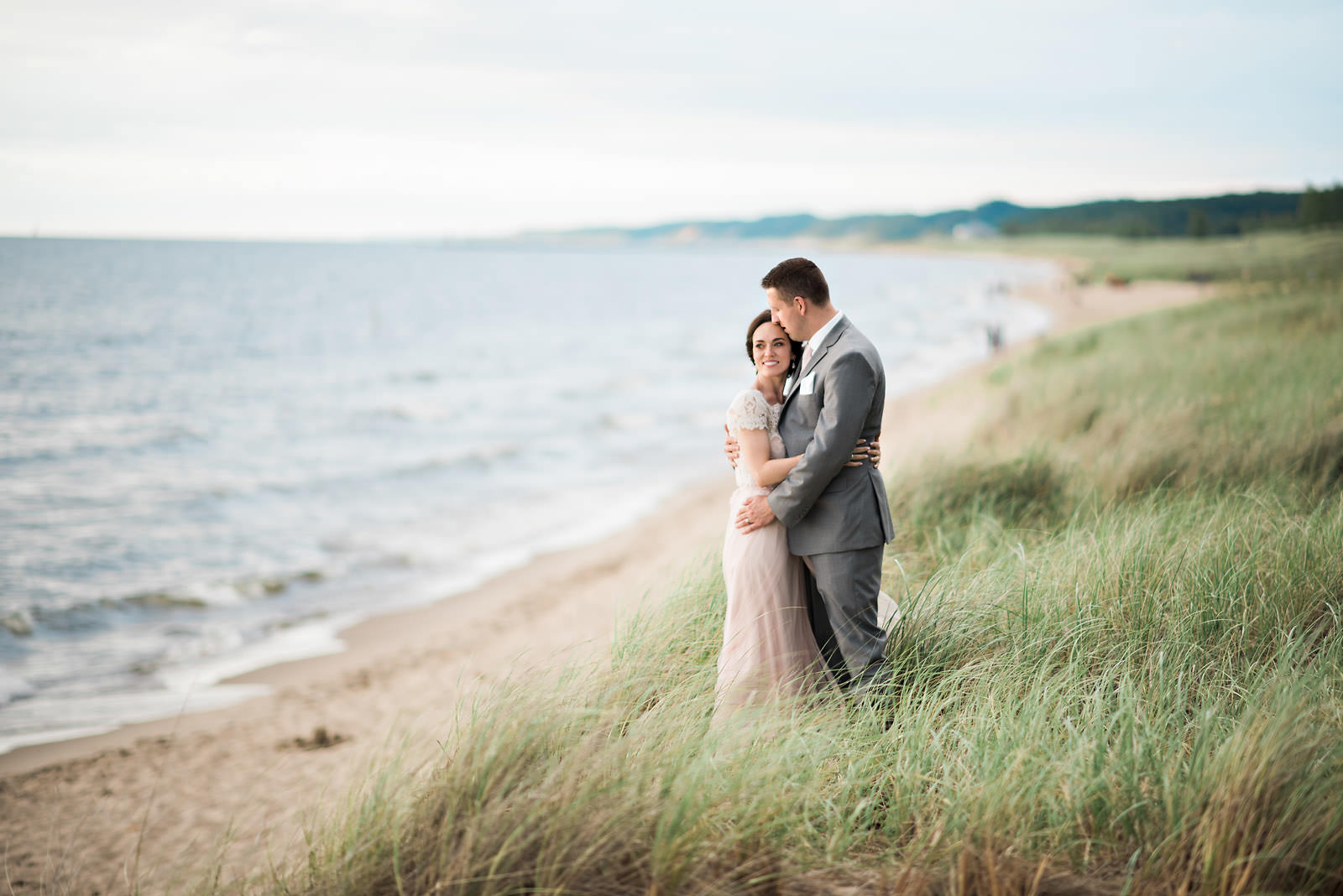 Bride-groom-in-tall-grass-dunes-lake-michagan