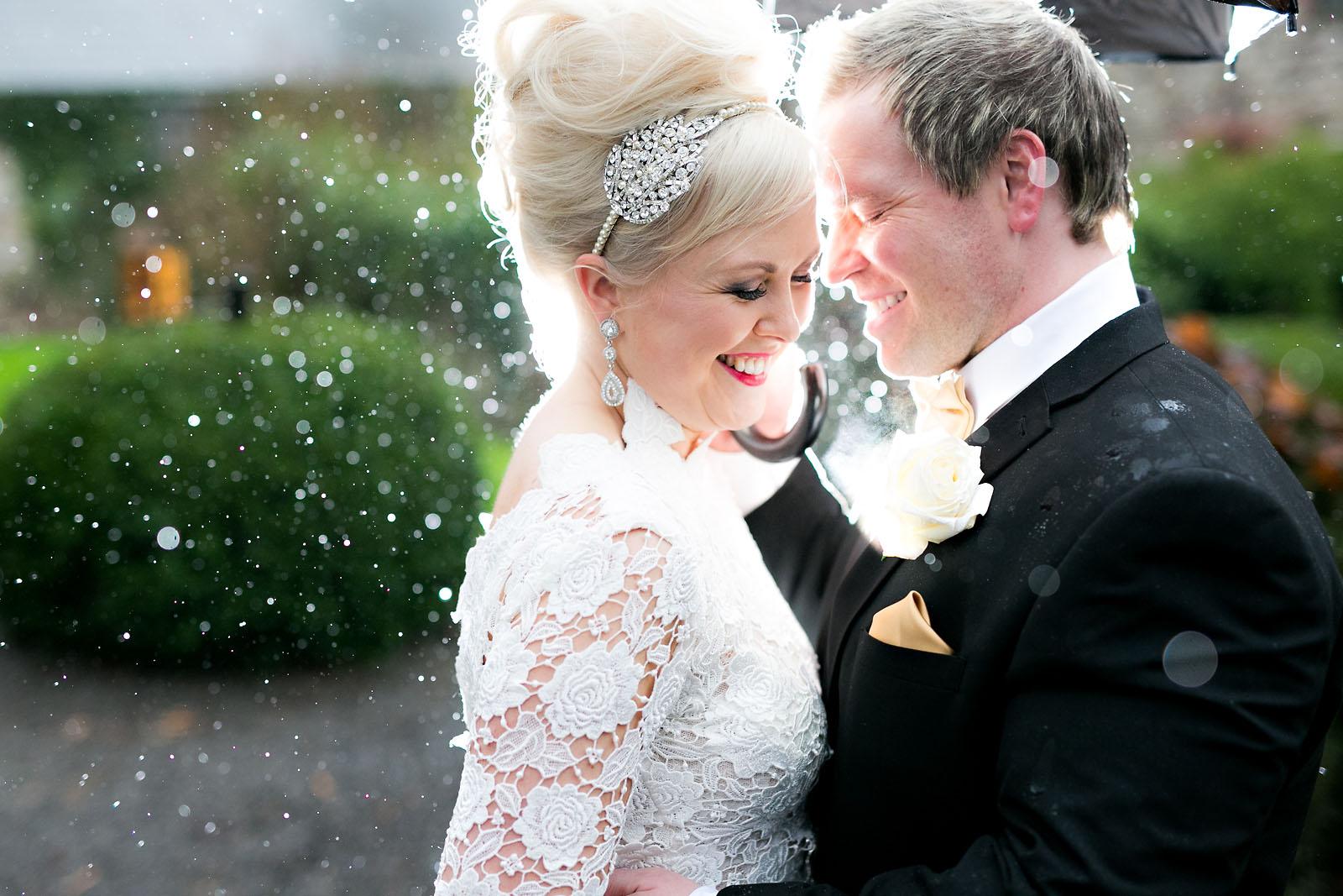 beautiful-blonde-bride-groom-rainy-wedding-day