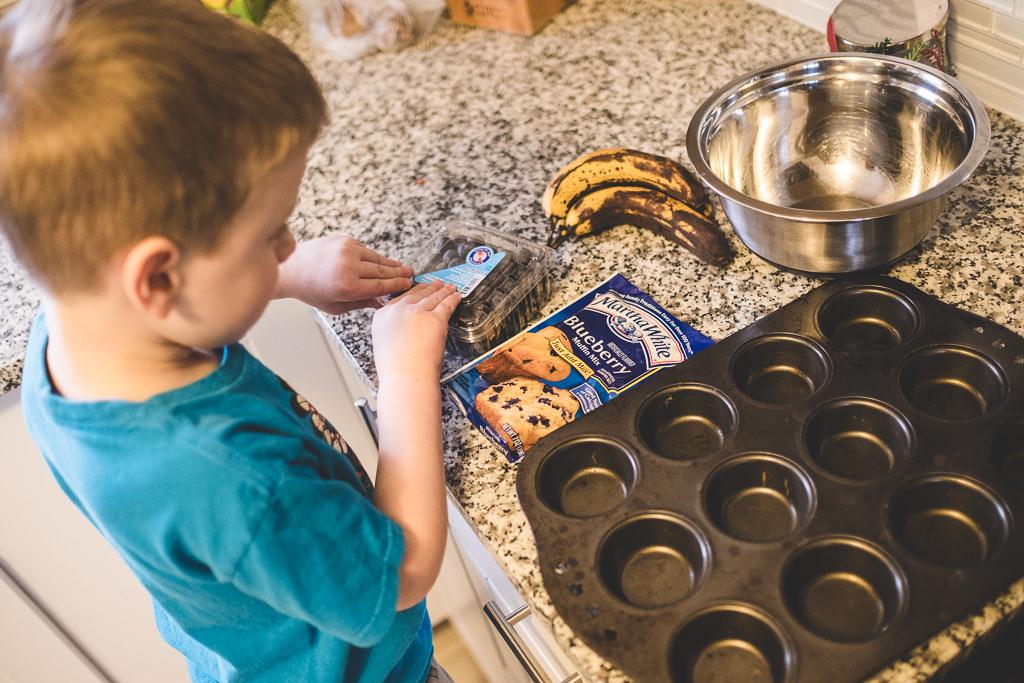 child gathering ingredients to bake muffins