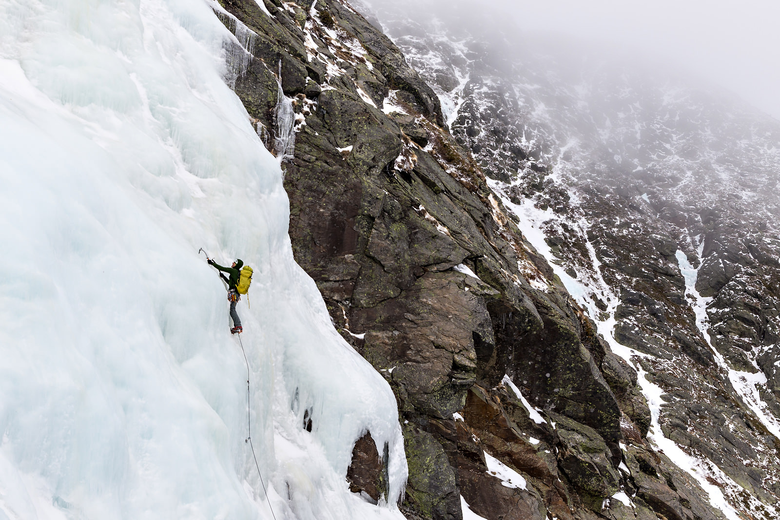 ice-climber-ascending-up-ice-wall-mountian