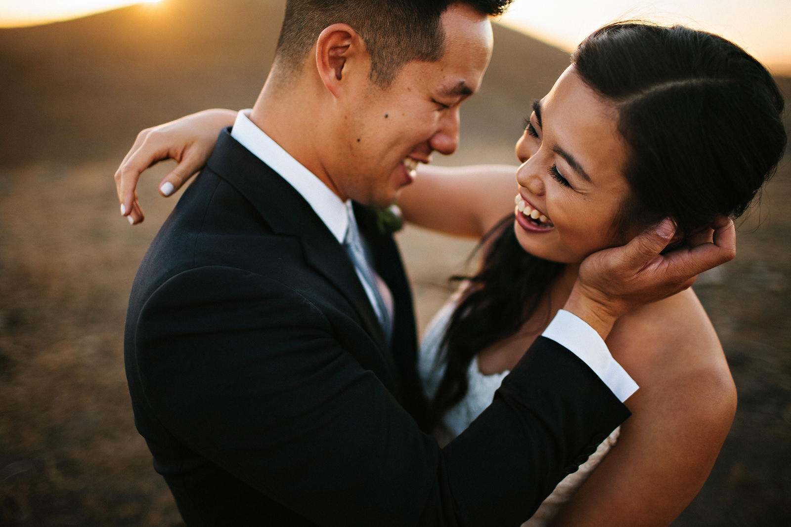 wedding-couple-laughing-together-sunset