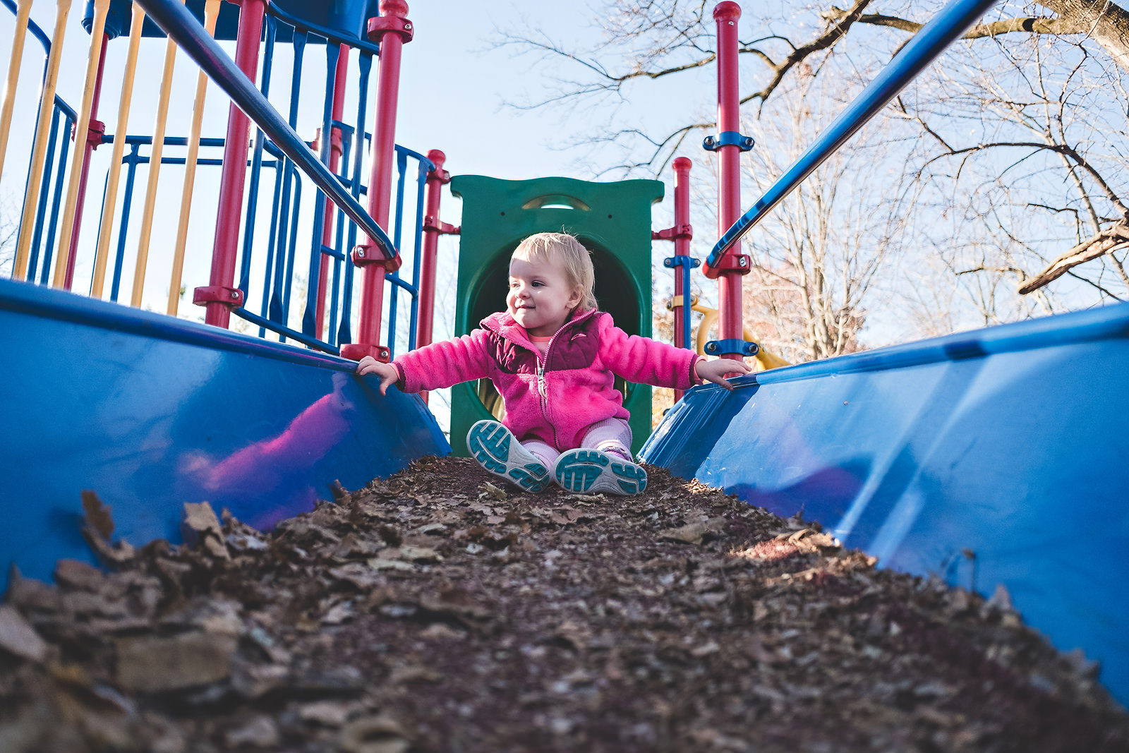 toddler-playing-at-park-in-fall-blue-ramp