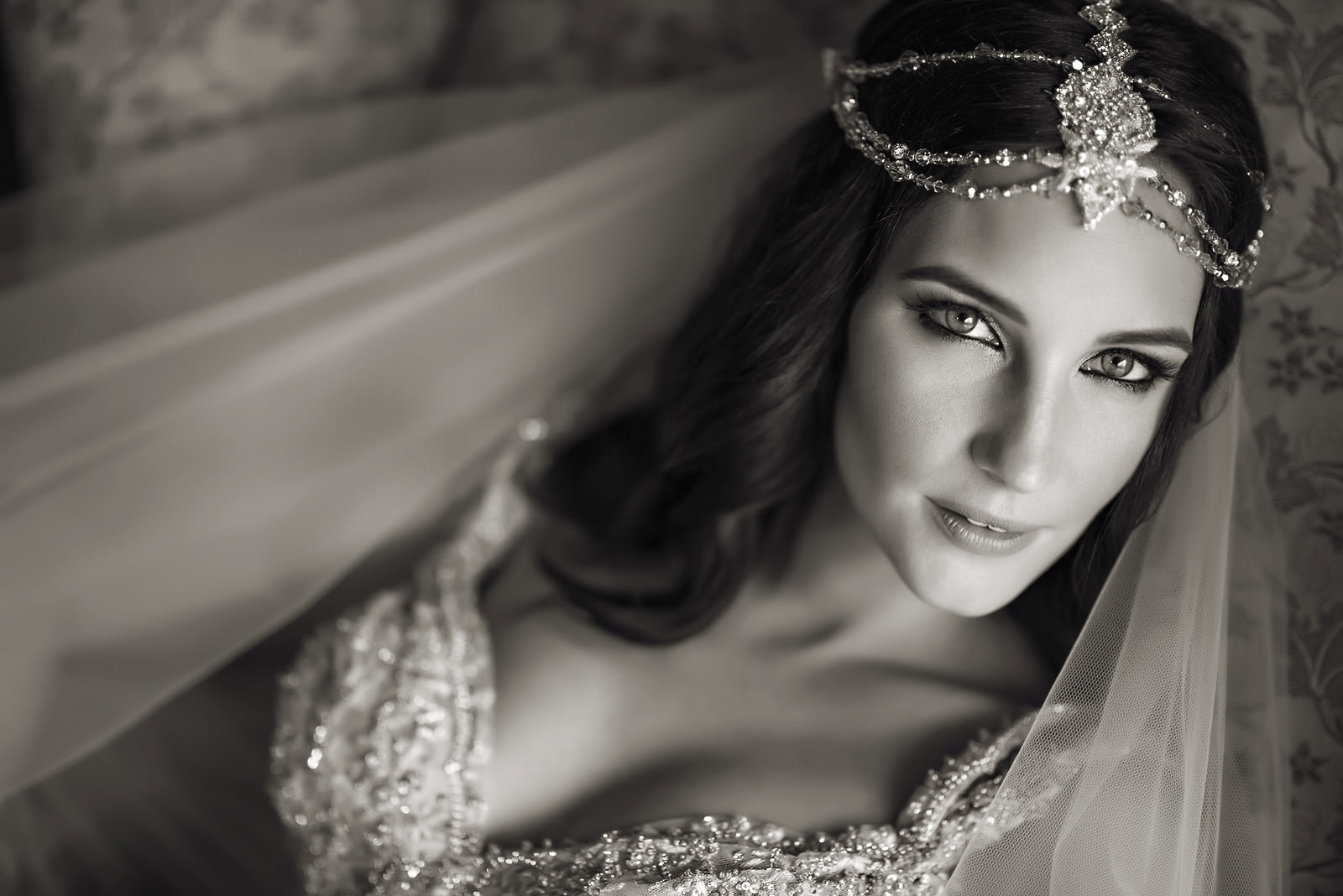 Bride with jewel crown looking out the window