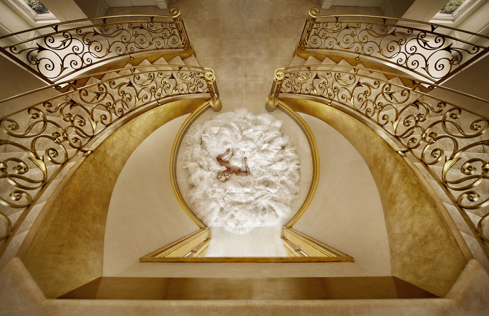 Bridal dress at the bottom of golden staircase