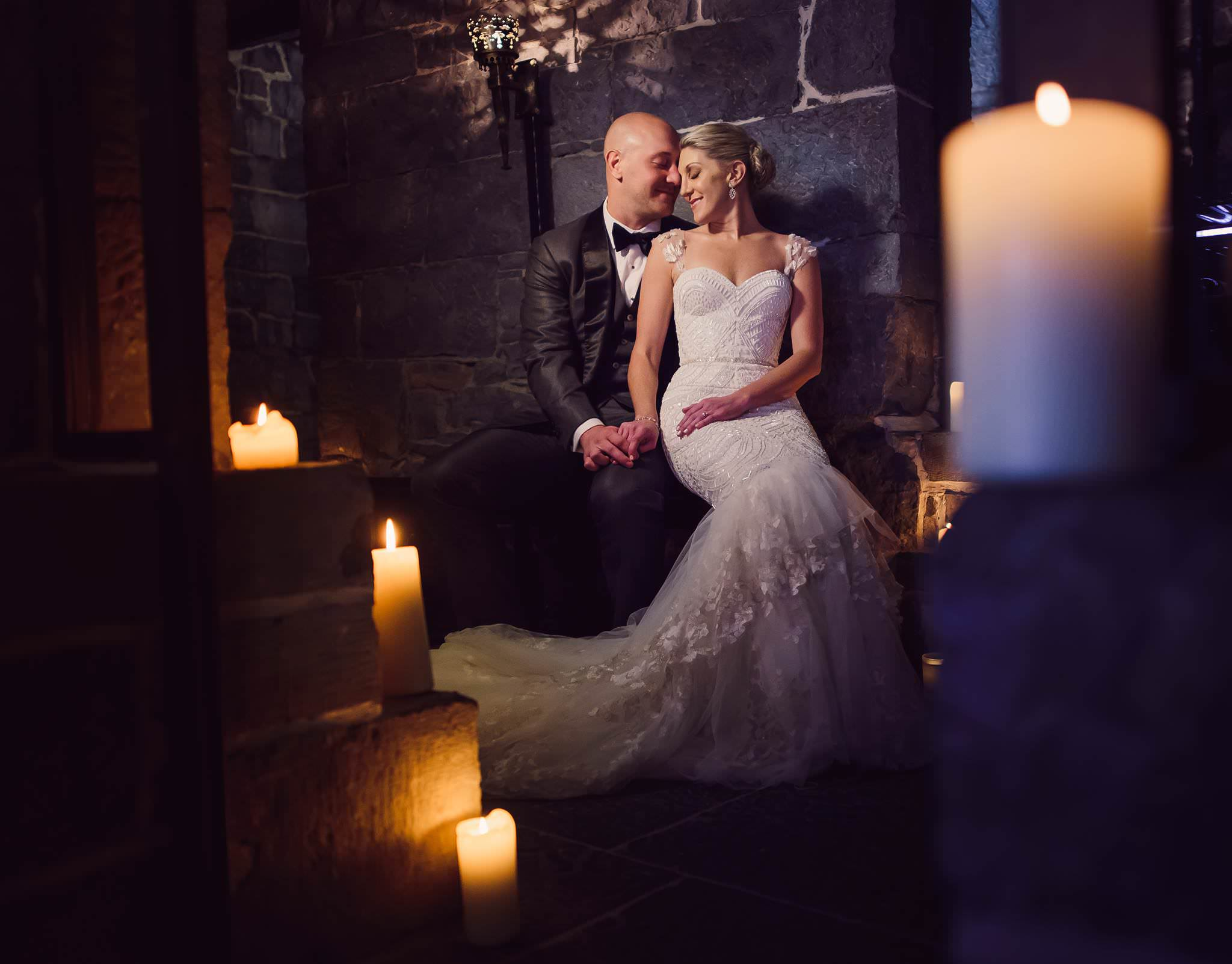 bride-groom-surrounded-by-candles