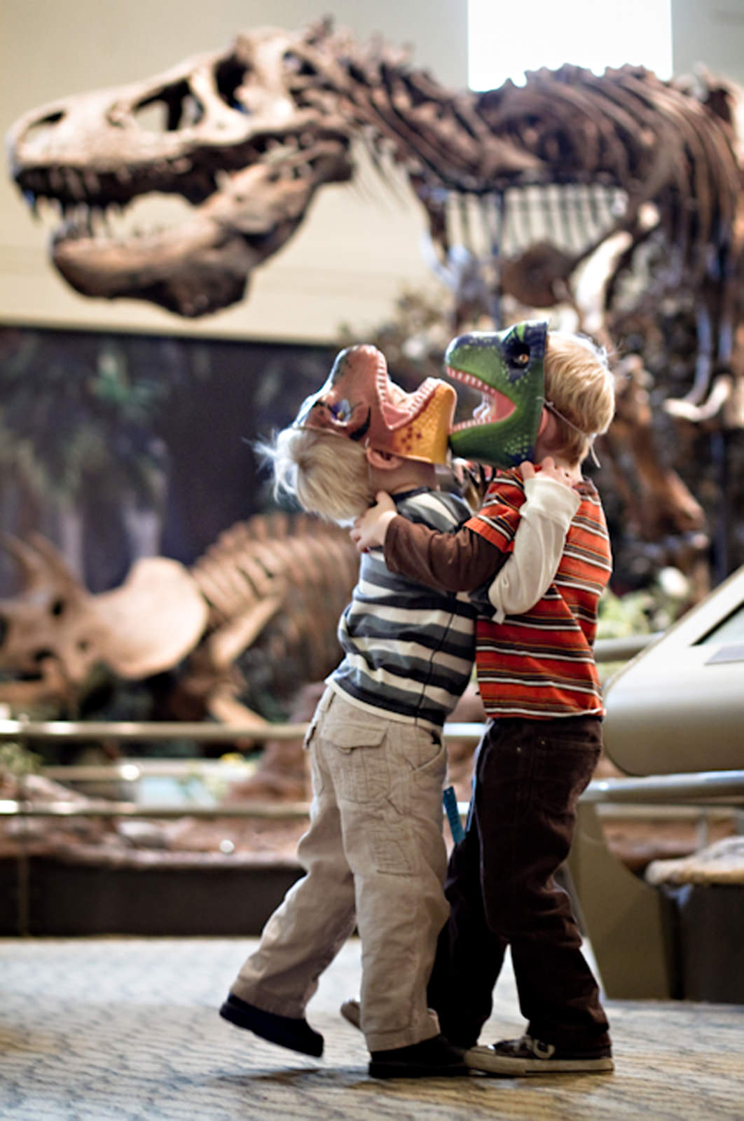 kids playing with dino masks