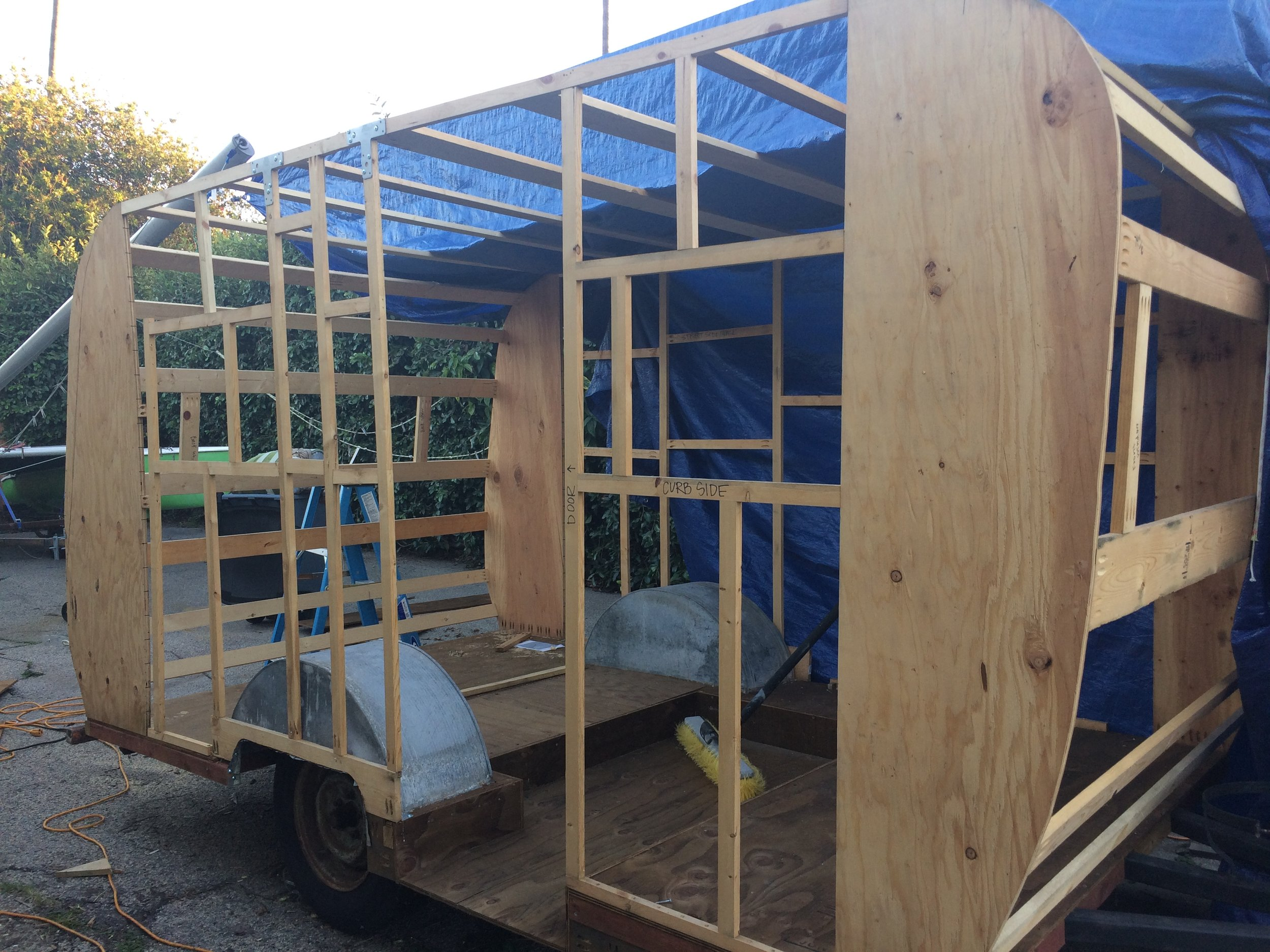 Framing completed! Please excuse the giant blue tarp. It's been raining like crazy here lately and we've rigged up quite an elaborate tent contraption that isn't very easy to remove for pictures