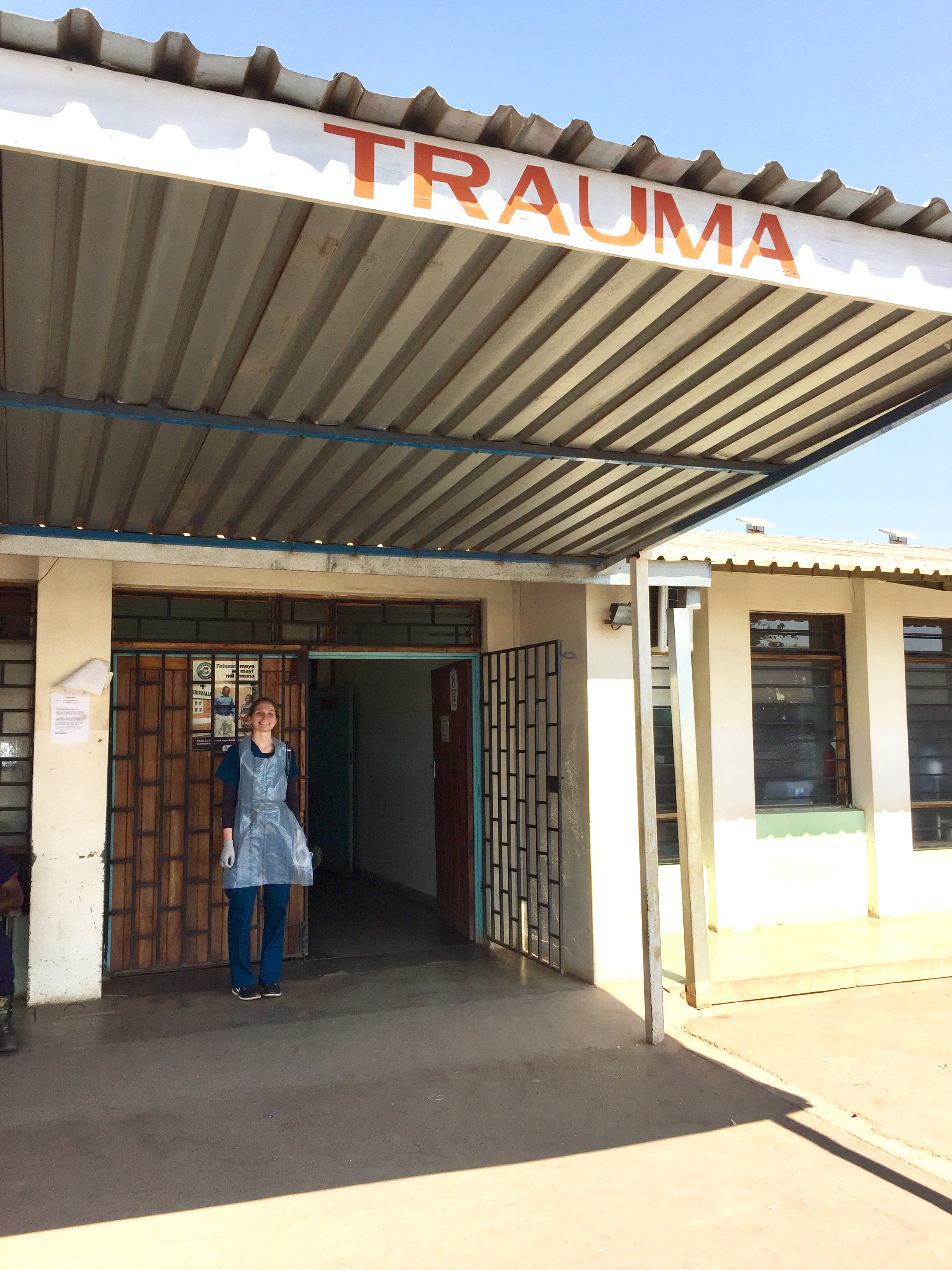 Lily stands outside of the Trauma unit at Kamuzu Central Hospital, July 2017.