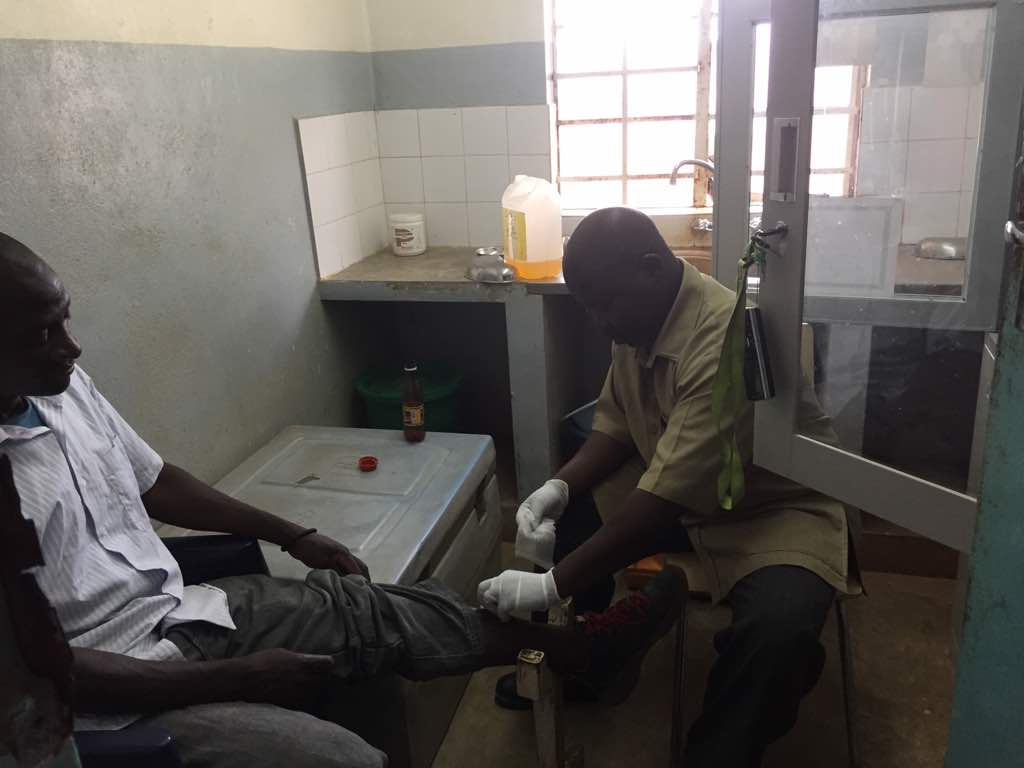 A Kabudula Community Hospital Clinician treating a patient in the current trauma room.