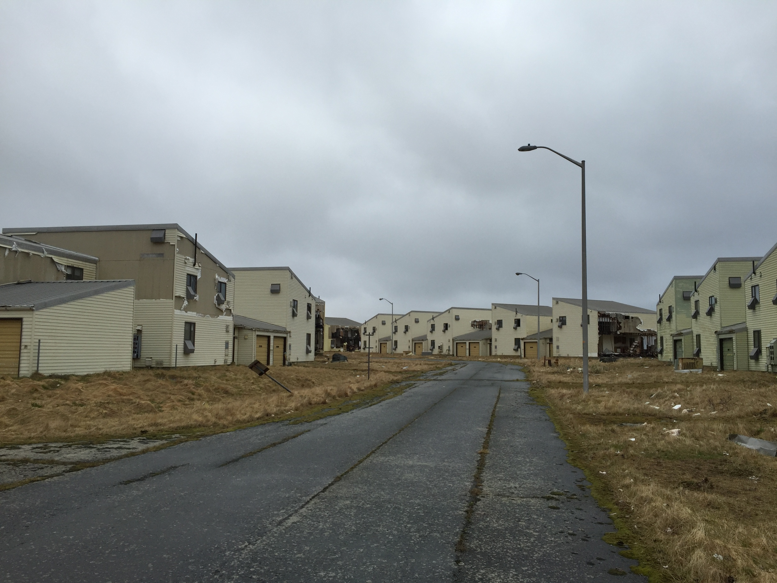 Abandoned houses ripped by winds slowly break down piece by piece, becoming part of the Adak landscape