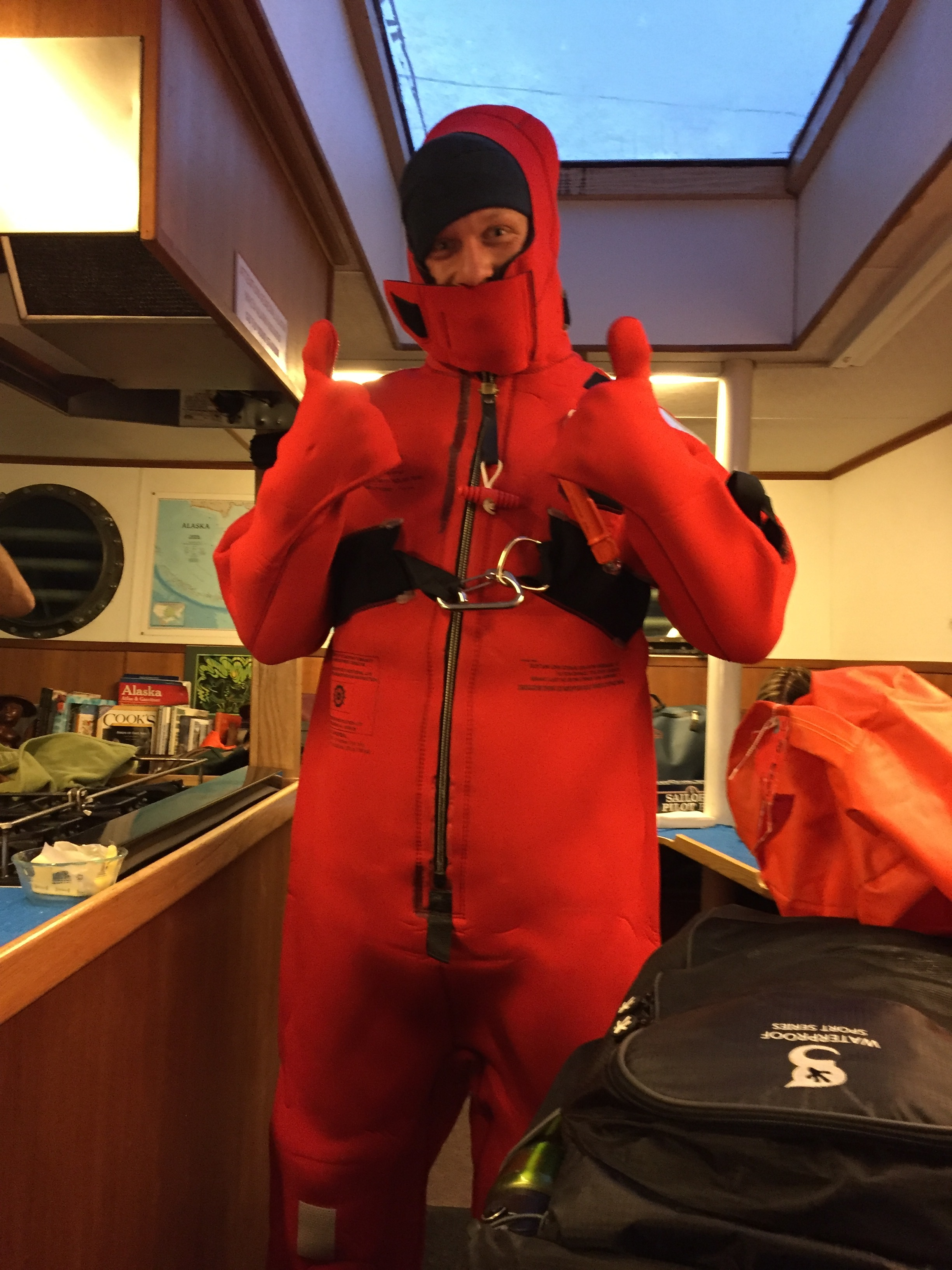 I give a thumbs-up after slipping into a cold-water survival suit in record-breaking time