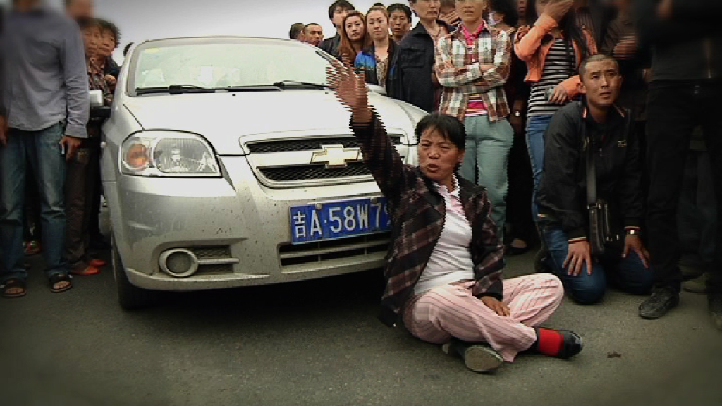 Families Protest Factory Blast