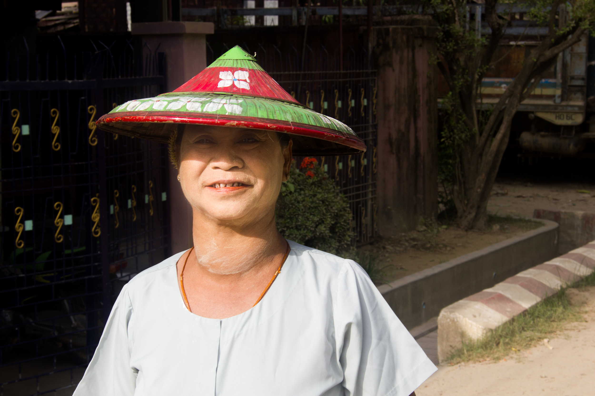 A woman of the Kayan tribe in northern Myanmar - her identity given away by the apparently 'stretched neck'. Notice the betel and tobacco stained teeth.