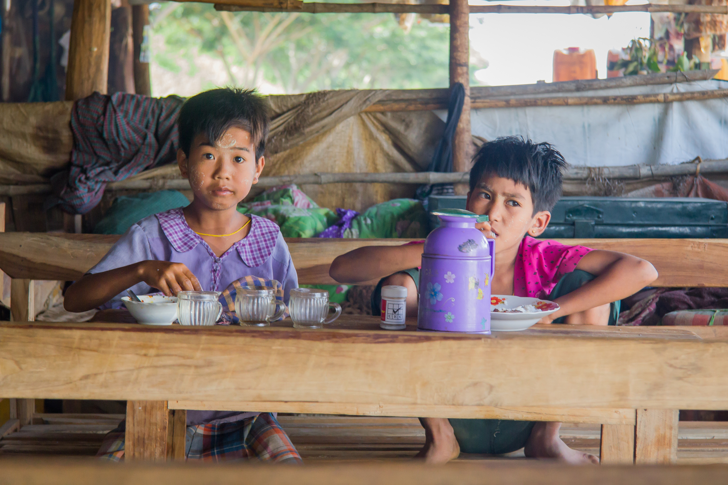 This cheeky duo served us some lunch in fits of laughter before tucking into their own at a popup roadside eatery near Napyidaw. Notice the purely decorative thanaka on the forehead.