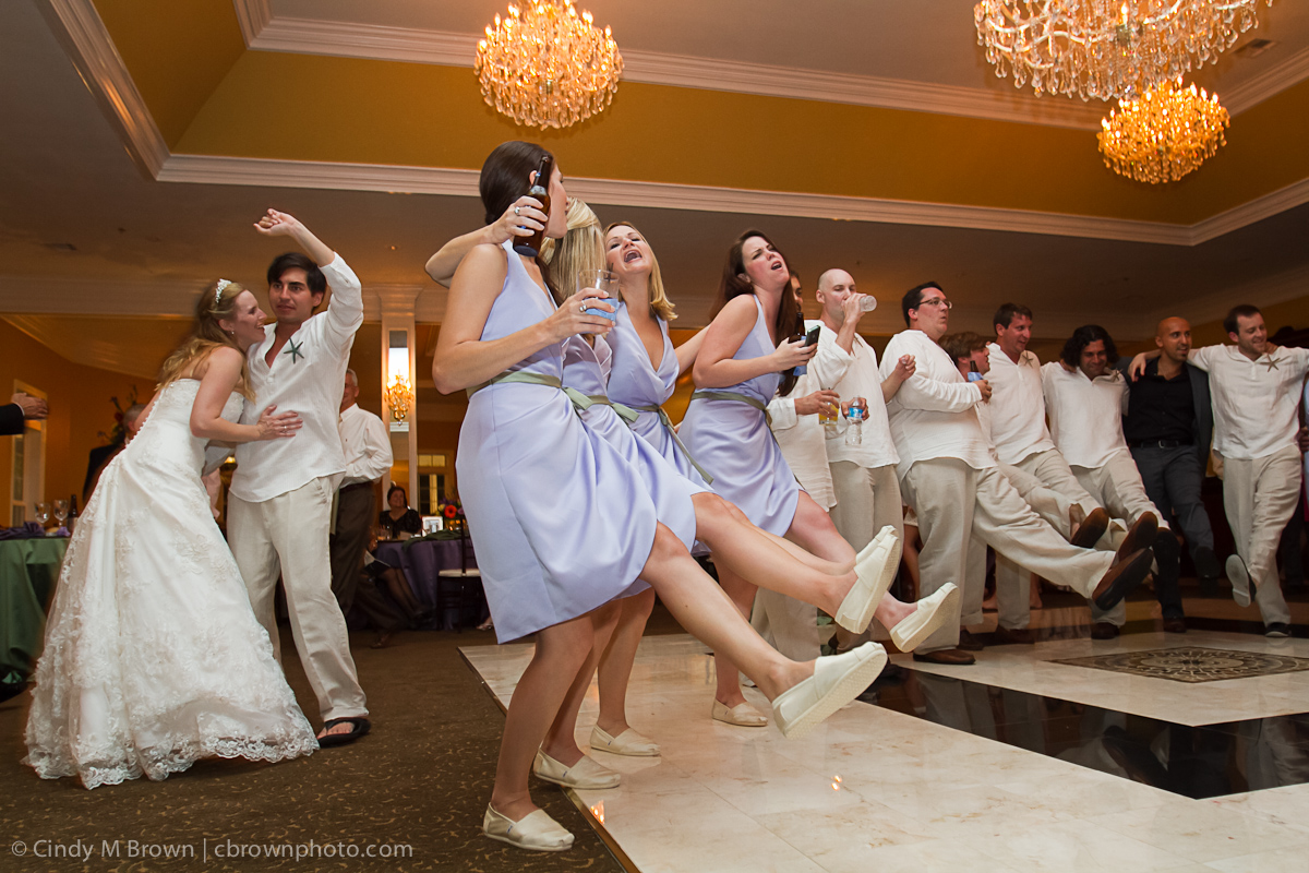 Dancing groomsmen and bridesmaids