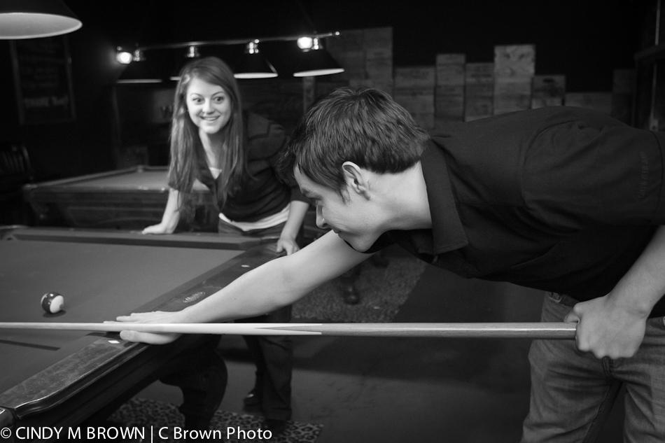 Adam at the pool table -- Lauren watching