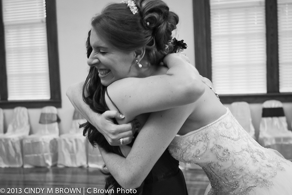Bride hugs bridesmaid