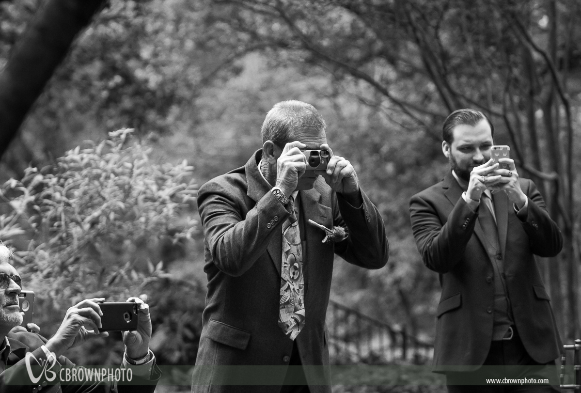 Wedding guests with cell phone cameras