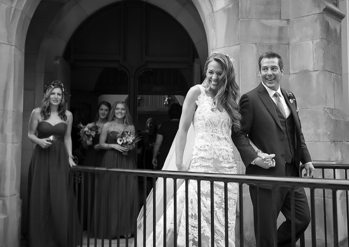 Candid Photo of Bride and Groom leaving the church after the ceremony by Cindy Brown.