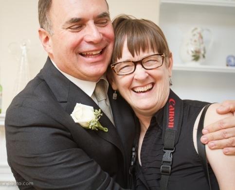Cindy with groom on day of wedding. photo by kara johnson