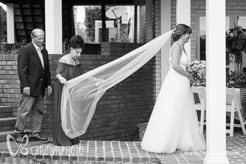 Rachael's Mom helps with the veil.