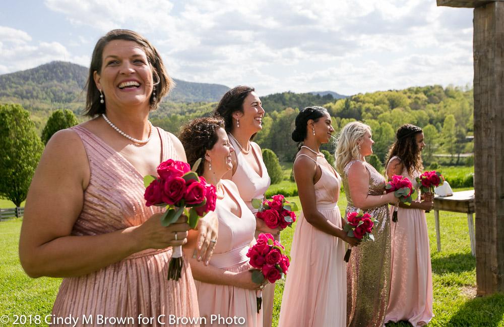 Beautiful bridesmaids with roses.