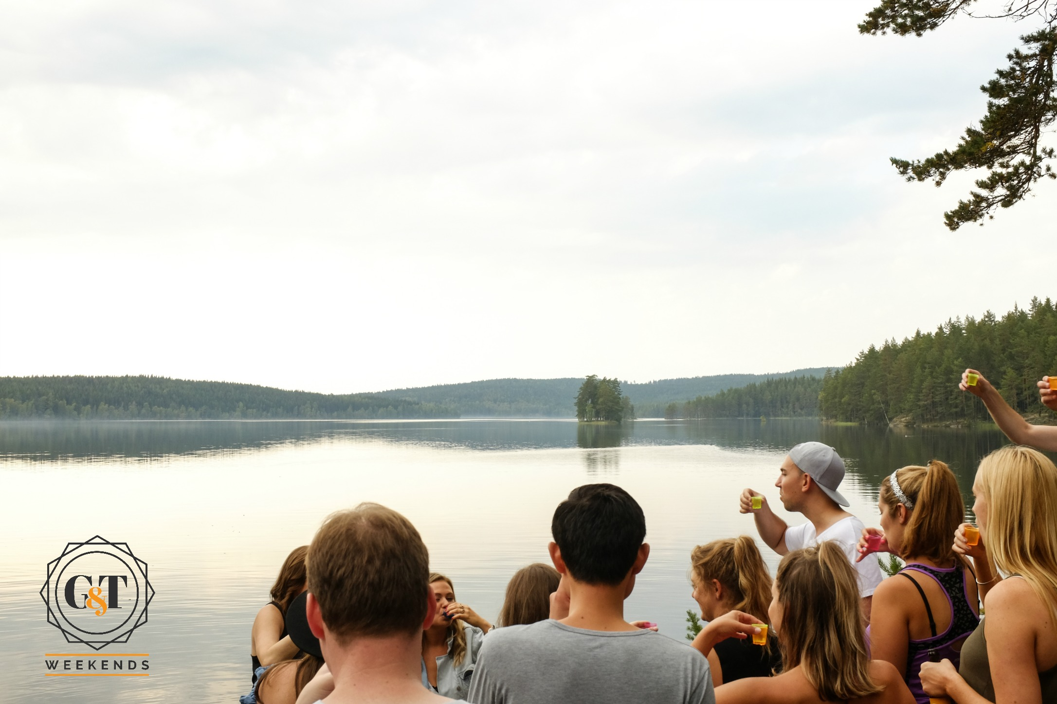 Drinking Aquavit by a Swedish lake on our luxury weekend away