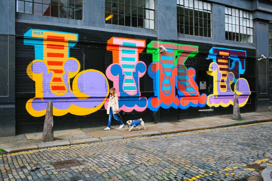 honeyidressedthepug-pug-puglife-streetstyle-shoreditch-london-graffiti-dog-pet-pugswag-coolpups-stylishdogs-ariandmm-trenchcoat-zerouv-mirrorlens-sunglasses-denim-pethaus-eastlondon-curlytail-squichyface-urbanpugswag-patches-cool-colours-streetart-sneakers-adidas-bangs-hound-meandmydog-rock-chic