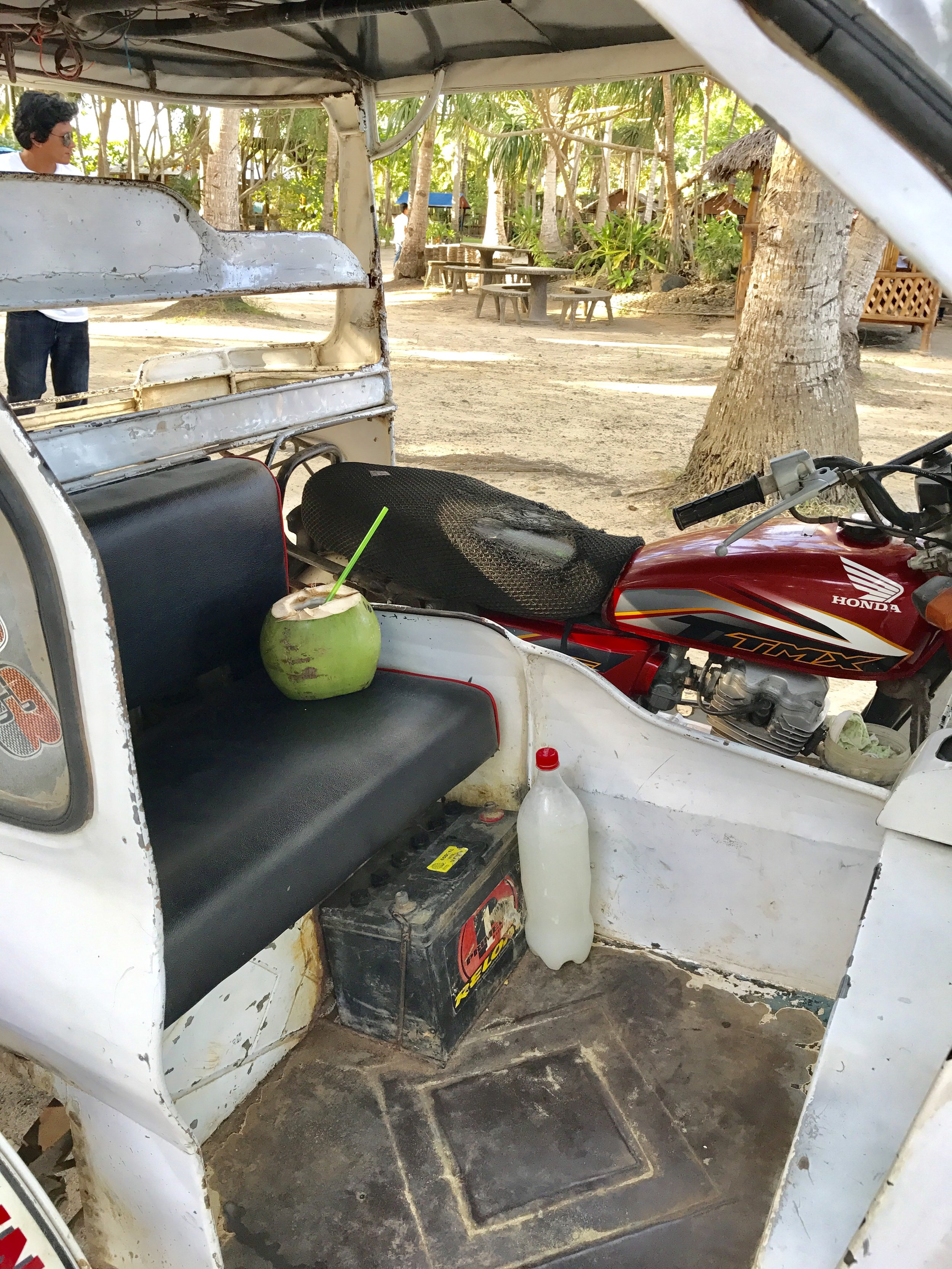 Coconut juice and a bottle of tuba in my tricycle