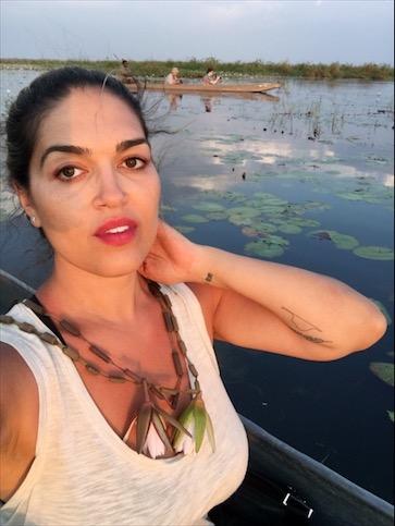 selfie in the Okavango Delta, Botswana with a shadow over my face