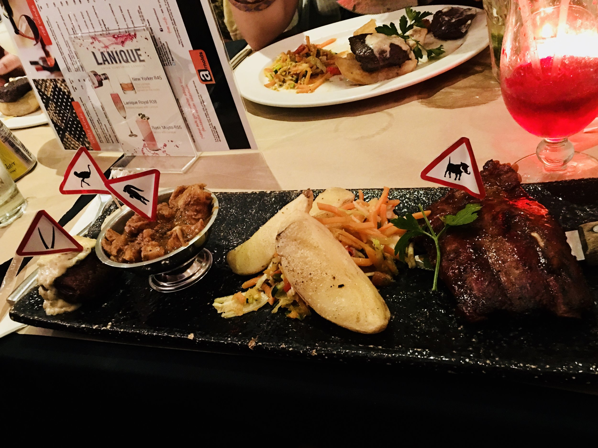 Did that menu really need to be there? Or that elbow? This dinner in South Africa was delicious though!
