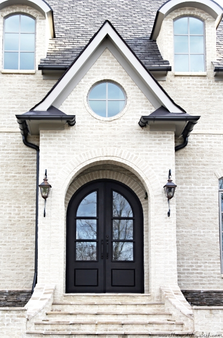 French country house with arched door