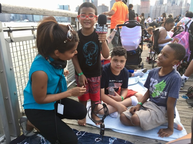 Getting ready for the fireworks and making some friends on the Pier in Long Island City