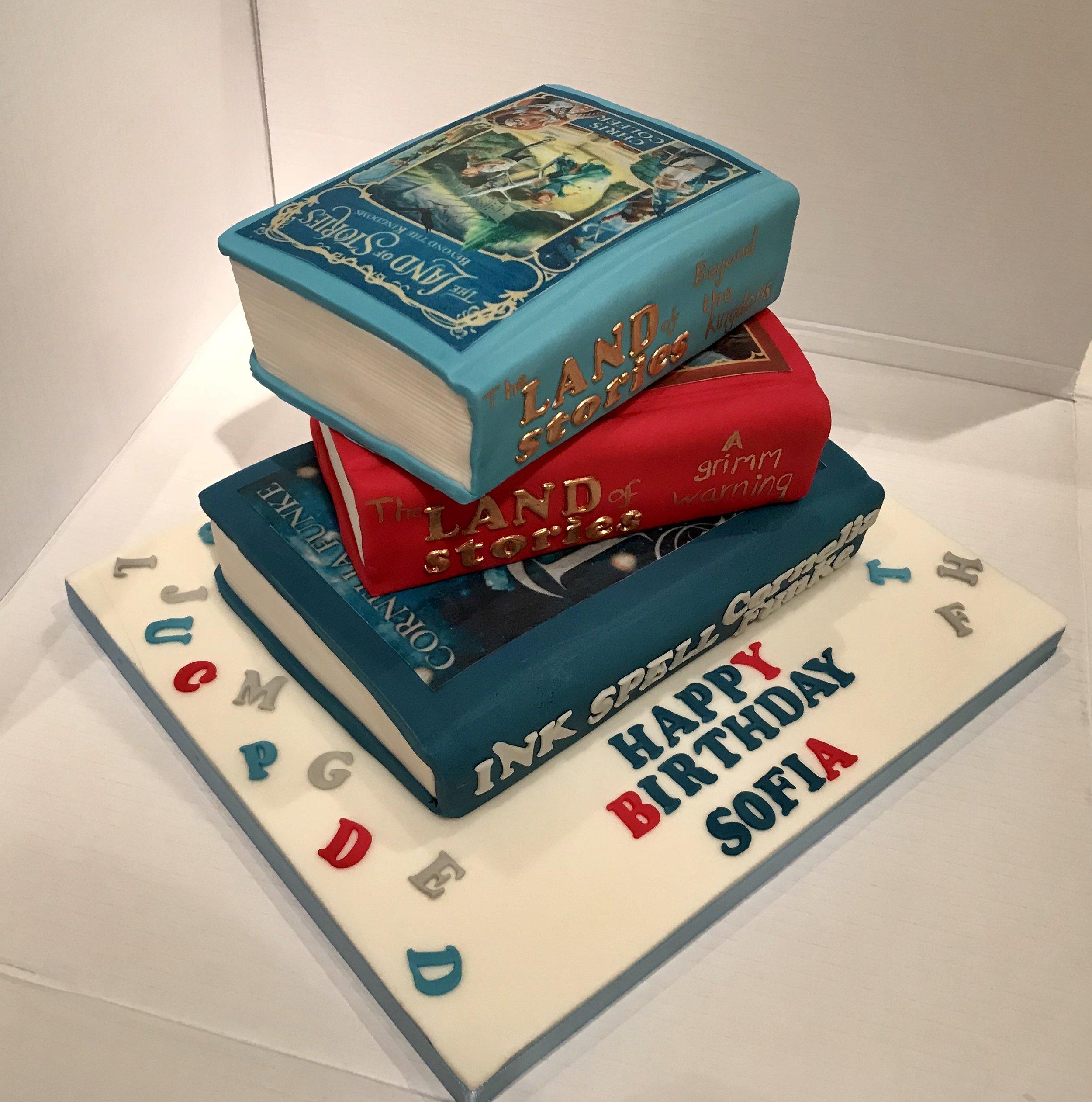 Sofia's favourite books made into cake! Lives in Cheltenham.
