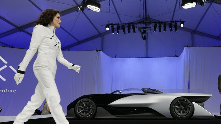 A driver walks in front of the FFZero1 by Faraday Future at CES Unveiled, a media preview event for CES International in Las Vegas in January. (Gregory Bull / Associated Press)