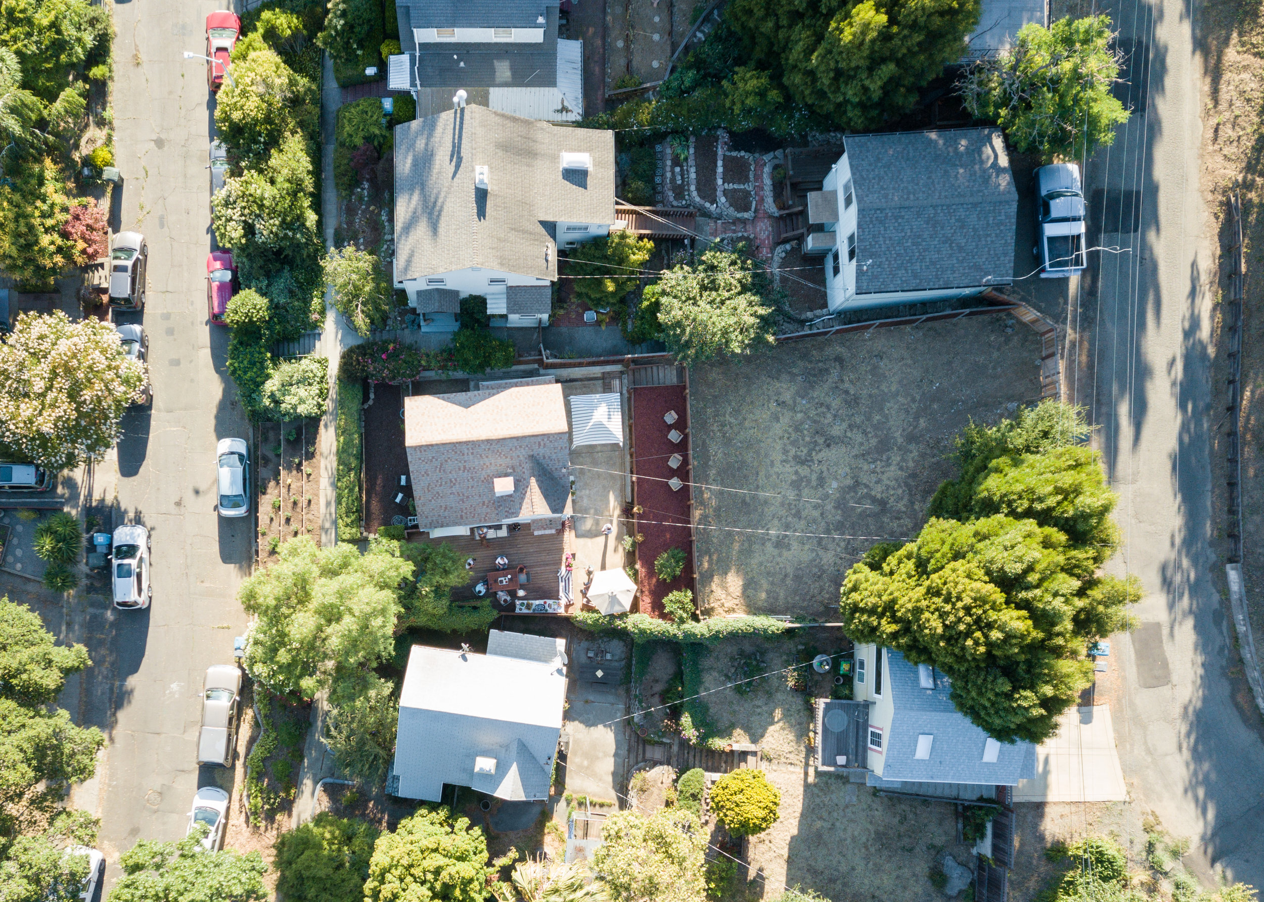 Aerial view showing Hillside Street running behind the property at the top of the lot.