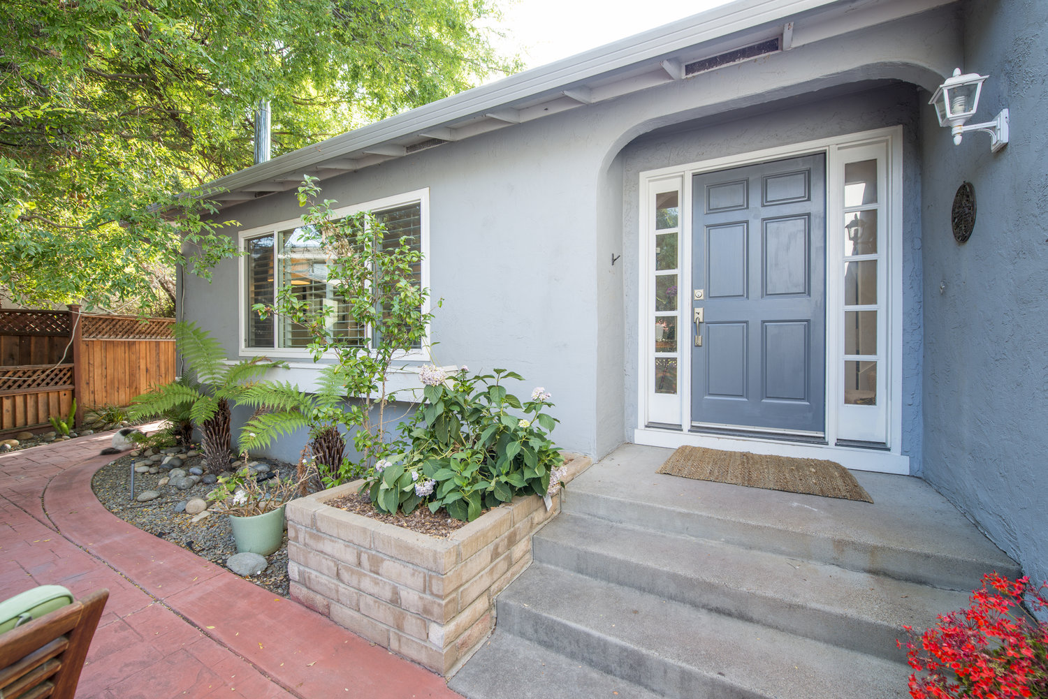 SUNNY AND BRIGHT   In the Mission neighborhood of Fremont, this sunny, open home is perfect for entertaining inside and out - front, back and side yards - all year round! Great floor plan with a fireplace in the family room and a wood stove in the living room, skylights in the bright kitchen and large master bedroom and, no rear neighbors!