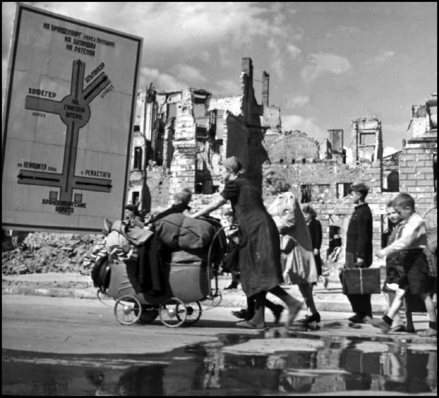Robert Capa © International Center Berlin. 1945. Refugees making their way through the ruined Soviet sector.